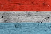 Grand Duchy of Luxembourg national flag. Painting is colorful on wood of old train carriage. Fastened by screws or bolts. poster