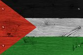 Palestine West Bank Gaza Strip flag. Painting is colorful on wood of old train carriage. Fastened by screws or bolts. poster