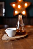 Coffee mug on a wooden table with bulb ryados poster