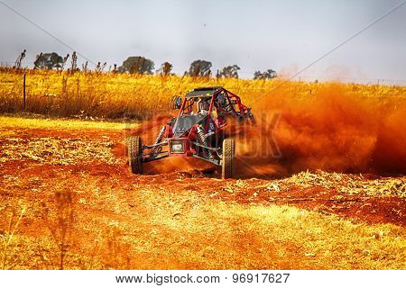 Hd - Custom Single Seater Rally Buggy Kicking Up Trail Of Dust On Sand Track During Rally Race.