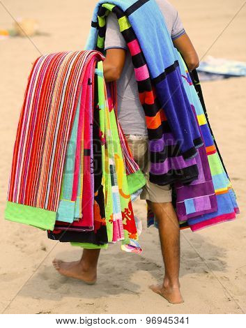 Peddler Of Towels And Beach Towels On The Beach In Summer
