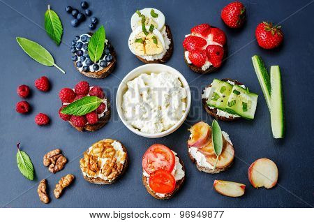 ricotta and crostini appetizers with fillings on a black background poster
