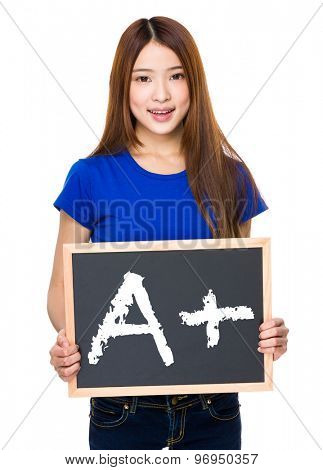 Young woman with black board showing A plus mark