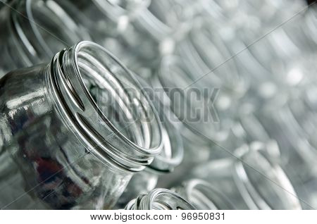 many empty jars for home-made preserves on glass background poster