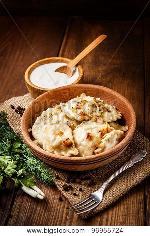 closeup of traditional ukrainian food - dumplings varenik poster