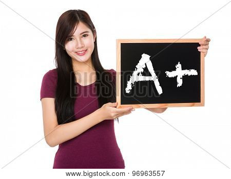 Asian woman hold with the blank chalkboard showing mark A plus