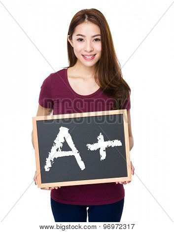 Young woman show with chalkboard mark A plus