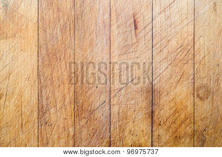 Wooden cutting board with vertical lines background