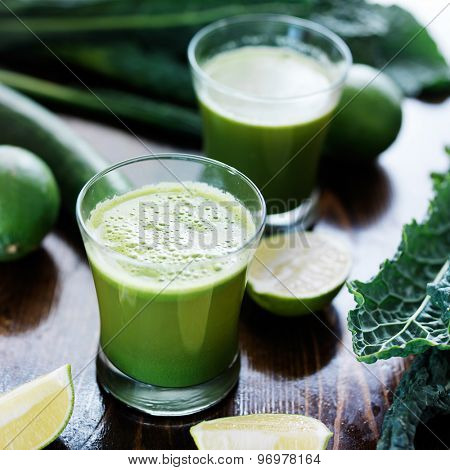 green smoothie made from juiced limes, lacinato kale and english cucumber and shot with selective focus