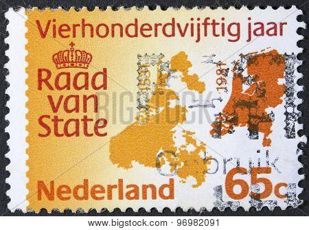 Postage stamp isolated on black.