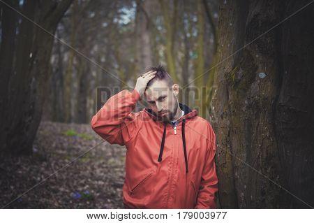 Trendy Handsome Man Posing In Spring Park Alone