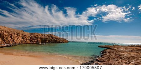 Hidden cove lost sandy bay with blue turquoise water in Ras Muhammad National Park in Sinai Egypt