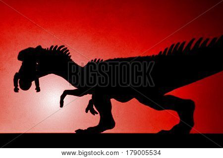 red spot light shadow of allosaurus biting a body on wall no logo or trademark