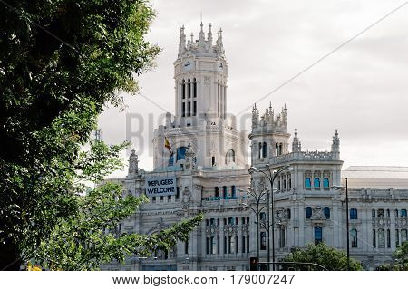 Madrid Spain - September 18 2016: New City Hall of Madrid with a banner with the words Refugees Welcome