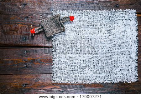 Knit shop background with burlap and cozy sweater holding needles