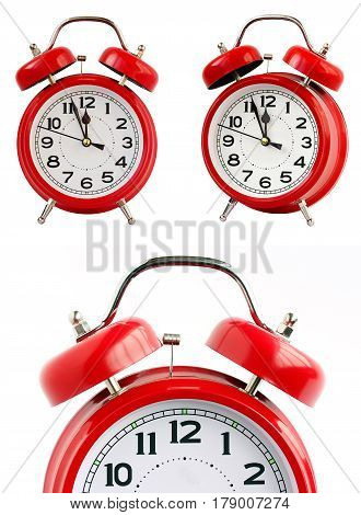 red retro alarm clock on a white background. midnight noon. minutes before the New year.