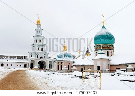 The new Jerusalem monastery Istra, Russia wall and the road to the bell tower in winter