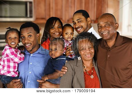 Multiple african american families who are standing together