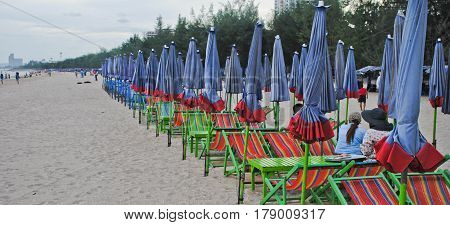 Beach chairs and umbrella ,Cha am beach Thailand