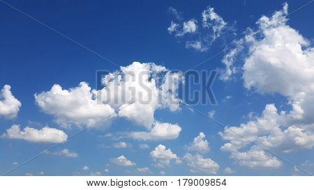 White Soft Clouds Covering A Deep Blue Summer Sky