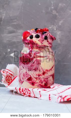 Vegan berry ice-cream shake in a jar. Love for a healthy vegan food concept