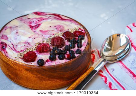 Vegan berry ice-cream shake in wooden bowl. Love for a healthy vegan food concept