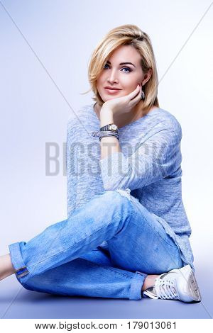 Portrait of a beautiful well-groomed middle-aged woman in casual clothes. Skincare, rejuvenation, cosmetics. Studio shot.
