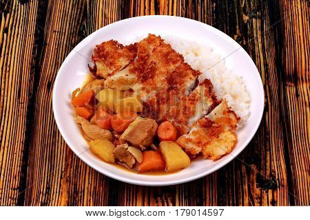 Rice With Deep Fried Dolly Fish In Japanese Yellow Curry.