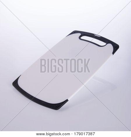 Cutting Board Or Plastic Cutting Board On Background.