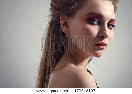 Young woman in bright makeup. Fashionable photo.