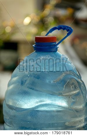 Top of Water bottle neck with blurred background.