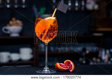 Alcoholic beverage based on table with ice cubes and oranges