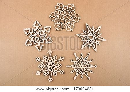 Laser cut wood snowflakes ornaments.  Wooden snowflakes on carton. Top view.