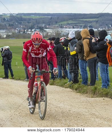 VendomeFrance- March 72016:The Slovenian cyclist Simon Spilak of Katusha Team riding on a dirty roadTertre de la Motte in Vendome during the first stage of Paris-Nice 2016.