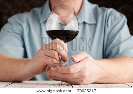 Man Sniffing Red Wine In A Glass, Close Up
