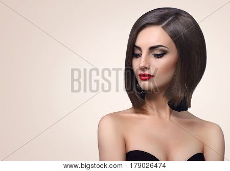 Beautiful elegant sensual young fashion model posing on beige background looking away copyspace sensuality femininity beauty fashion salon skincare cosmetics classy concept