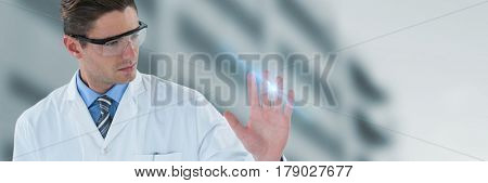 Doctor touching transparent interface against low angle view of defocused building