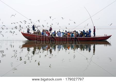 Tourists Taking A Boat Tour On The Sacred Ganges River