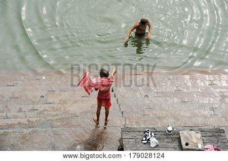 Hindu Pilgrims Take A Holy Bath In The River Ganges
