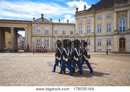 The ceremony of changing the Royal Guard in Amalienborg Castle in Copenhagen in Denmark