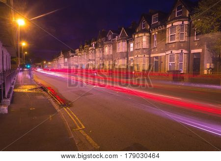 Evening Exeter. Street with night lights. You can see tracers from cars passing by. Devon. England