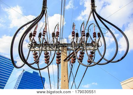 an electric pole with wires and Buck Arm type