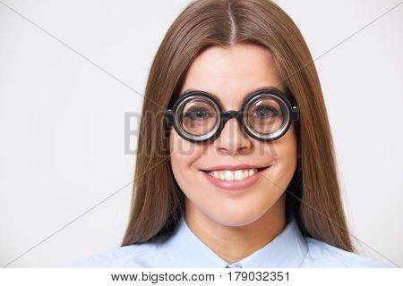 Studio Portrait Of Funny Happy  Young Business Woman In Nerd Eyeglasses Isolated On Gray.