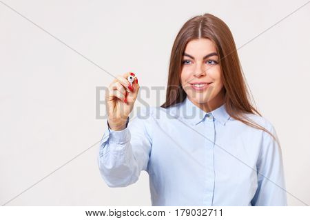 Young Beautiful Business Woman Writing On A Transparent Copyspace.