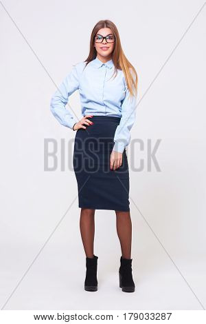 Full Body Studio Shot Of Young Business Woman On Gray Background.
