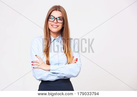 Studio Portrait Of Beautiful Young Business Woman On  Gray Background.