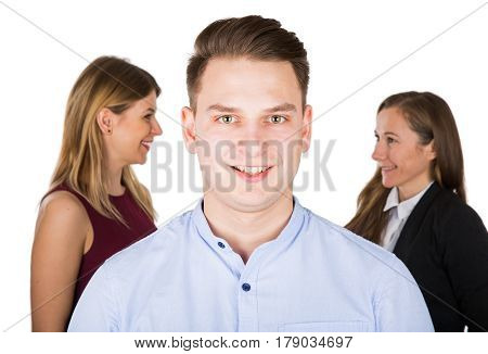 Picture of a young man choosing between two beautiful strong woman bigamy