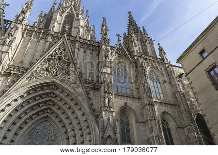 Facade of the Cathedral of Barcelona located in the old part of the city, catalonia, spain