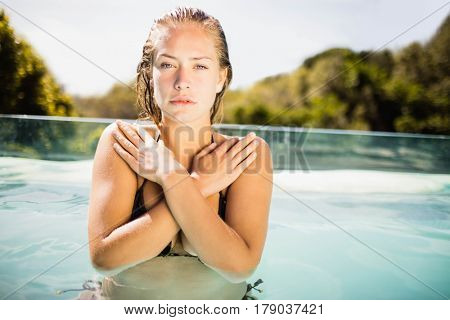 Beautiful blonde in the pool looking at the camera