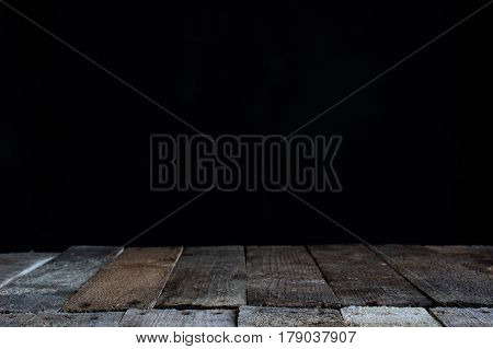 Black background with sticks on the countertop
